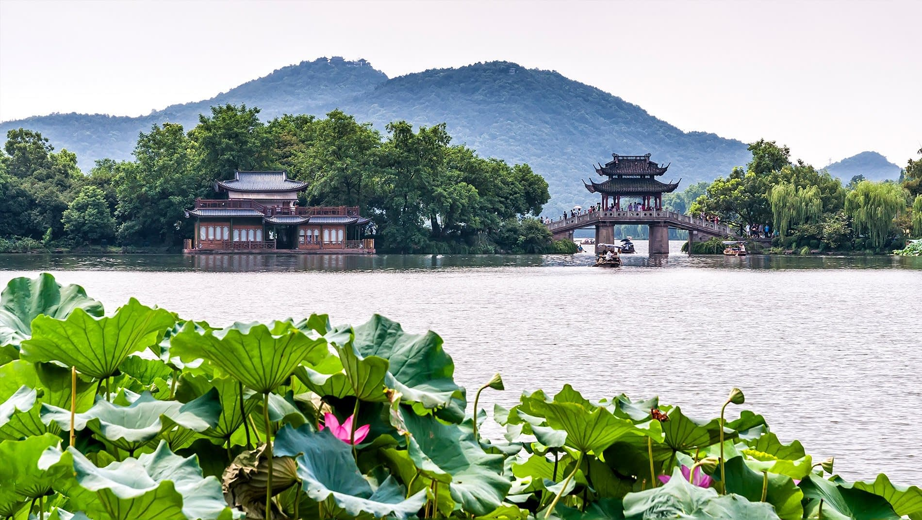 West Lake~West Lake has defined scenic elegance in East Asia for many centuries. Visitors will see its lakeside willow trees, ornamental bridges and causeways as a quintessentially Chinese idiom.