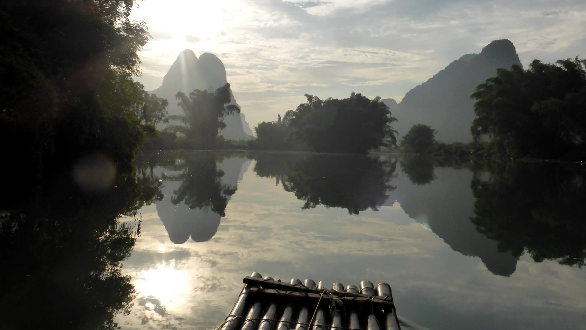 Li River~Feel your cares drift away with the current as you are punted along the river though the stunning karst landscape. Children run to school along the river bank, villagers collect clumps of reeds to weave into mats, farmers hide from the sun under thatched shelters on their adjacent fields.