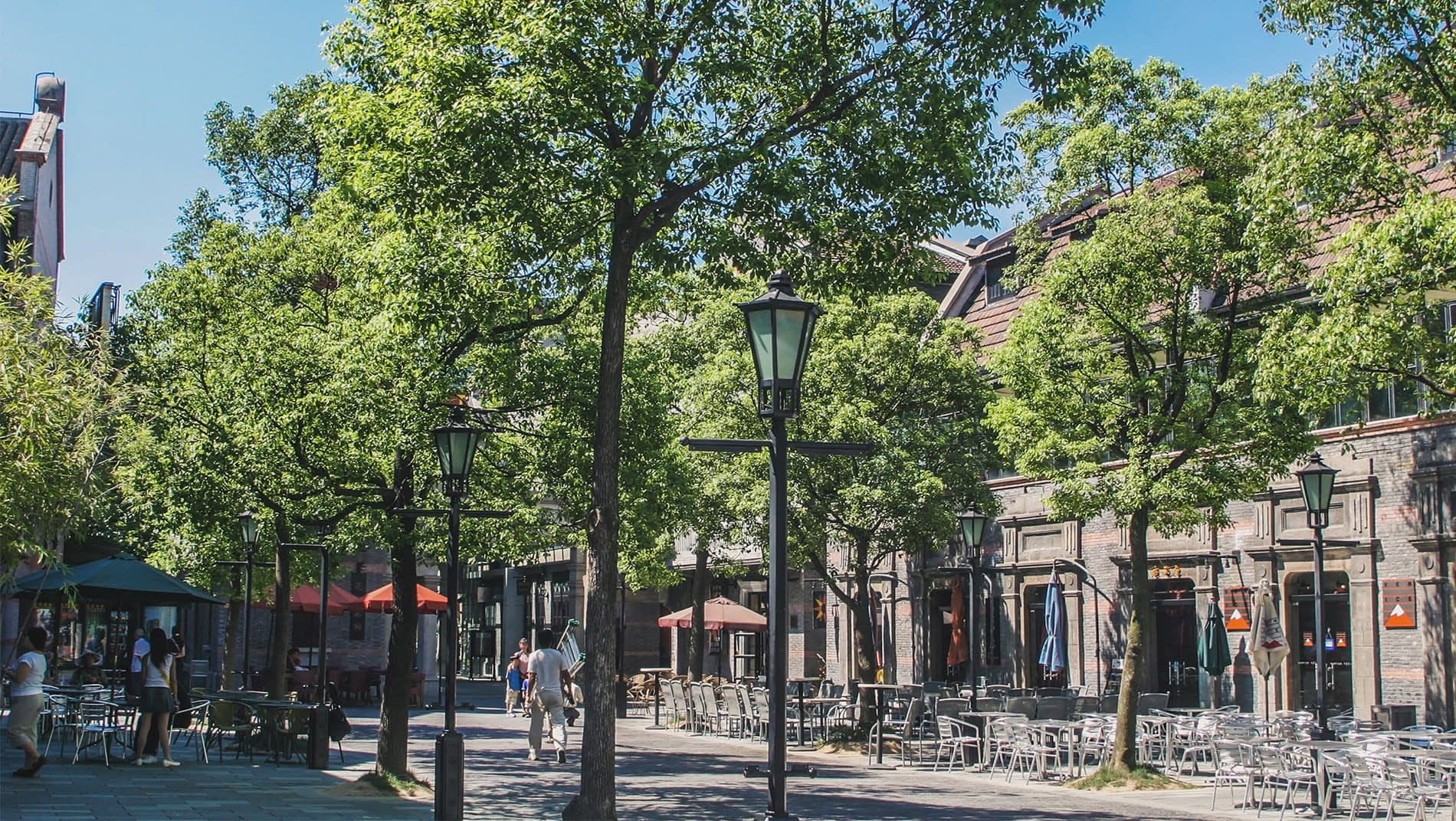 French Concession~A canopy of French poplars, planted either side of its graceful streets, creates plentiful shade under which to amble through the French concession. Its mansions and apartments incorporate Art Deco styles from all over the world.