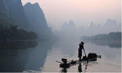 Fisherman on the misty Li River