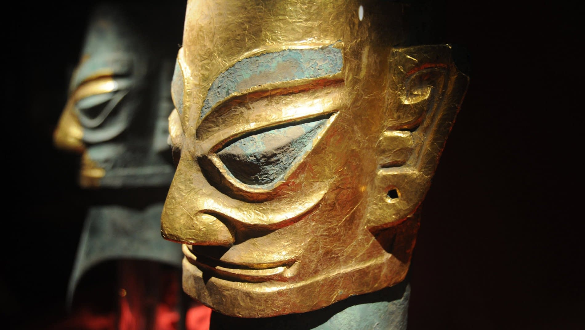 Sanxingdui~Excavated in 1986, the burial pits at Sanxingdui disgorged an amazing treasure trove of golden scepters, gold masks from the size of your pinky to the width of a table and 20 feet tall bronze trees of life; all about three thousand years old.