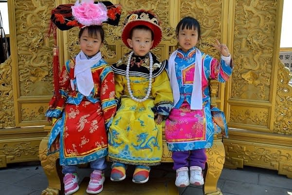 Children getting photographed in costume