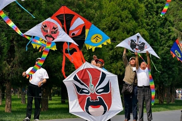 Flying traditional kites in the park